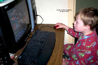 Kids with Down Syndrome love to play and work on computers.