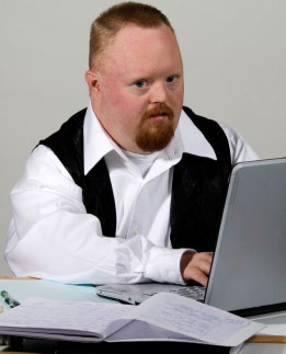 Adult man with Downs syndrome working or studying