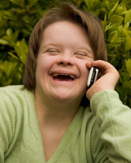 Adult woman with Down's syndrome using mobile phone