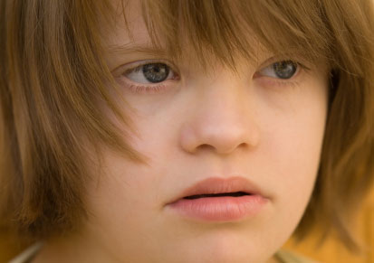 Close up of girls face with Down syndrome