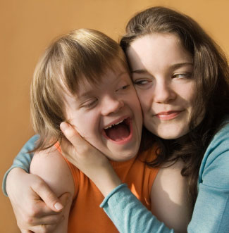 Girl with Down syndrome with sister