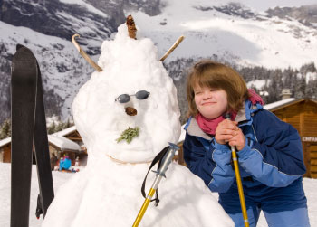 Older girl with down syndrome, with the snowman she made