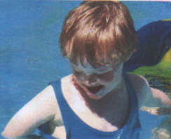 Jacob, at age 6 years is enjoying his swimming instruction and the water, the Down Syndrome is NOT an issue with proper caring instructors.