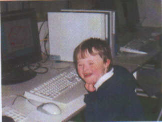 Jacob, aged 6 years, working on the school computer - kids with Down Syndrome normally love to work on computers.