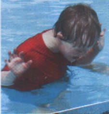 Jacob, aged 6 years, learning to swim - a kid with Down Syndrome can learn to do just about anything with good caring instructors.