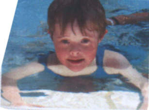 Jacob, a kid with Down Syndrome, aged 6 years, learning to swim - this picture included because he looks so good.