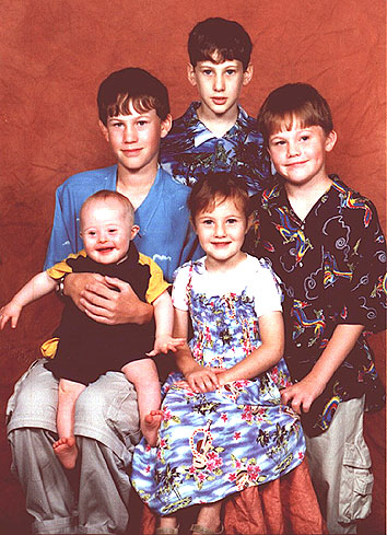 Jacob, with Down Syndrome, aged 1 year, with his brothers and sister.