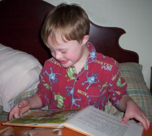 Jacob, age 6, using his intelligence in learning to read - A kid with Down Syndrome should not be limited in their growth by other peoples perceptions - most kids with Down Syndrome can go on to live productive lives within the community.
